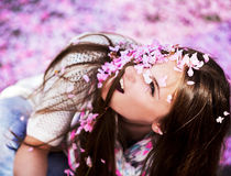 Women showered with pink petals Royalty Free Stock Photo