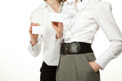 Women showing blank badges stock image