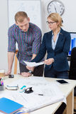Women showing business plan to coworker Royalty Free Stock Photos