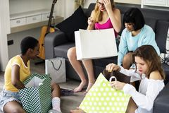 Women showing friends shopping shoes royalty free stock photos