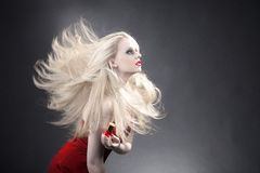 Women side view with flying hair Stock Images