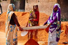 Women sifting soil in Agra, India. stock image