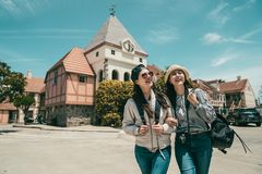 Women sightseeing and walking cheerfully stock image