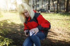 Women sign geocaching logbook Royalty Free Stock Photography