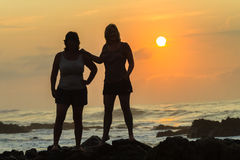 Women Silhoueted Sunrise Ocean Stock Photos