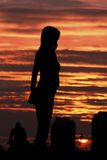 Women silhouette. Woman silhouette looking into the sunset Royalty Free Stock Photo