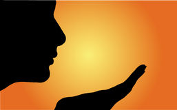 Women silhouette. With orange sunset Stock Images