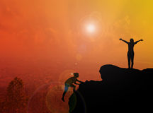 Women silhouette climbing and standing on cliff with blurred cit Stock Photos