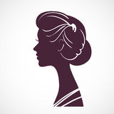 Women silhouette head with beautiful stylized hairstyle. Stock Photos