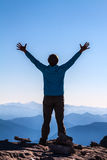 Women silhouette on the top of mountain Royalty Free Stock Photography