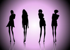 Women silhouettes. 4 fashion women silhouettes in vectors Stock Images