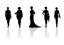 Women silhouettes 2. Five black fashionable female silhouettes on a white background with shadows Stock Image