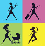 Women silhouettes on a colored background.  Silhouettes of women Stock Image