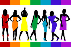 Women silhouettes with rainbow color dresses Royalty Free Stock Photos