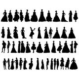 Women silhouettes in various dresses Stock Photos