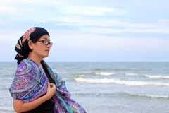 Women and silk scarf at seaside Stock Images