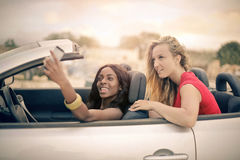 Women in a silver cabrio stock image