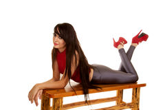 Women silver pants red heels lay on stomach Stock Photography