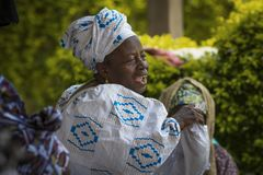 Women singing and dancing traditional songs at a community meeting in the city of Bissau, Guinea-Bissau. Bissau, Republic of Guinea-Bissau - January 31, 2018 royalty free stock photography