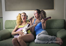 Women singing and playing the guitar Stock Photo