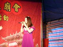 Shenzhen, China: temple fair entertainment, women singing Royalty Free Stock Images