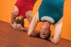 Women in Sirasana Position Royalty Free Stock Photos