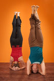 Women In Sirsasana Position Royalty Free Stock Images