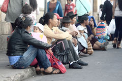 Women sit on bordure, the street in Sucre Stock Photography