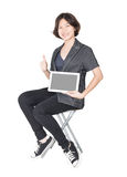 Women sit on chair with using mobile phone. Asian woman sit on chair with using mobile phone ,Cut out isolated over white background Royalty Free Stock Image