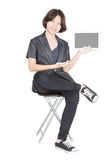 Women sit on chair with using mobile phone Royalty Free Stock Image
