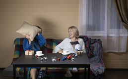 Women in home clothes drink tea royalty free stock image