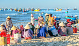 Women sit inside group fish market fishing port village Royalty Free Stock Photography