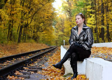 Woman sits near a railroad Stock Photography