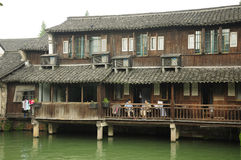 Women sitting on balcony Wuzhen China Stock Photo