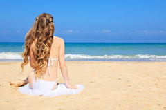 Women sitting on the beach Stock Image