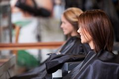 Women Sitting in Beauty Salon Stock Images