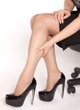 Women is sitting on the chair Royalty Free Stock Photography