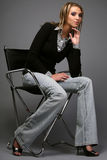 Women sitting on the chair. Portrait of young attractive women sitting on the chair Royalty Free Stock Photo