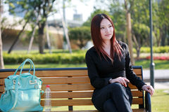 Woman sitting on chair outside Royalty Free Stock Photography