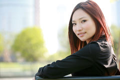 Women sitting on chair outside Stock Photos
