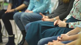 Women sitting in circle during session with psychologist. Meeting young and beautiful girls club,woman hands at the psychological training stock footage