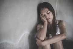 Women sitting on the floor crying with depression, Depressed woman, family problems, Stress, kitchen, abuse, Domestic violence,. The concept of depression and royalty free stock images
