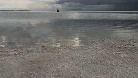 A women sitting on the lake,Tuz Golu (Salt Lake) stock footage