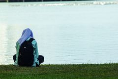 Women sitting by the lake. royalty free stock photography