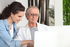 Women sitting at a laptop Stock Photography
