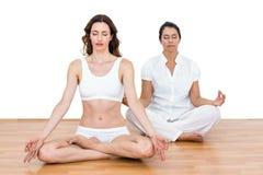 Women sitting in lotus pose Stock Image