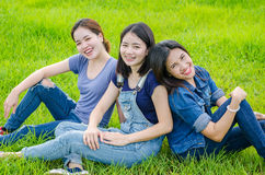 Women sitting in meadow and smile Stock Photos