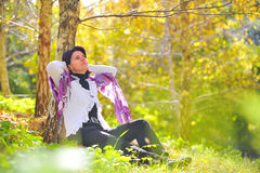 Women sitting in the park Stock Images