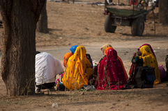 Women sitting by the roadside. Indian women sitting by the roadside wearing colourful sarees Royalty Free Stock Photography
