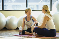 Women Sitting and Socializing at Gym Stock Images